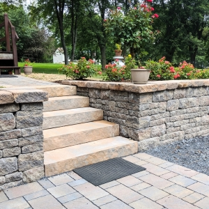 Belgard Brookshire stone-texture retaining wall with precast concrete steps and a paver driveway in New Paltz, NY, designed by Ulster County Landscapers Masseo Landscape, Inc.
