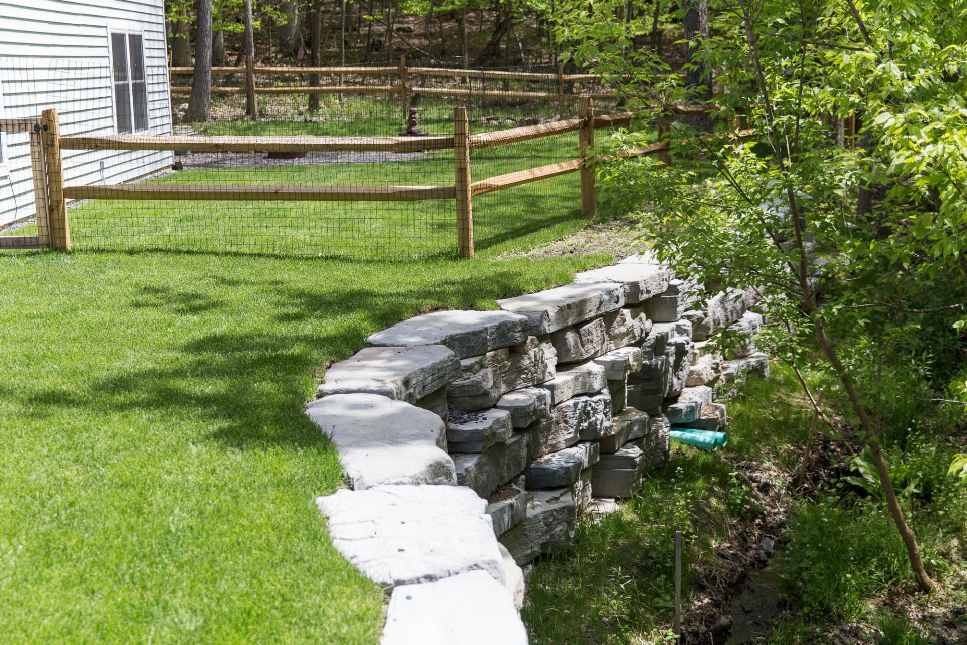 Retaining wall expands yard space in New Paltz, NY by Masseo Landscape, New Paltz Landscaper