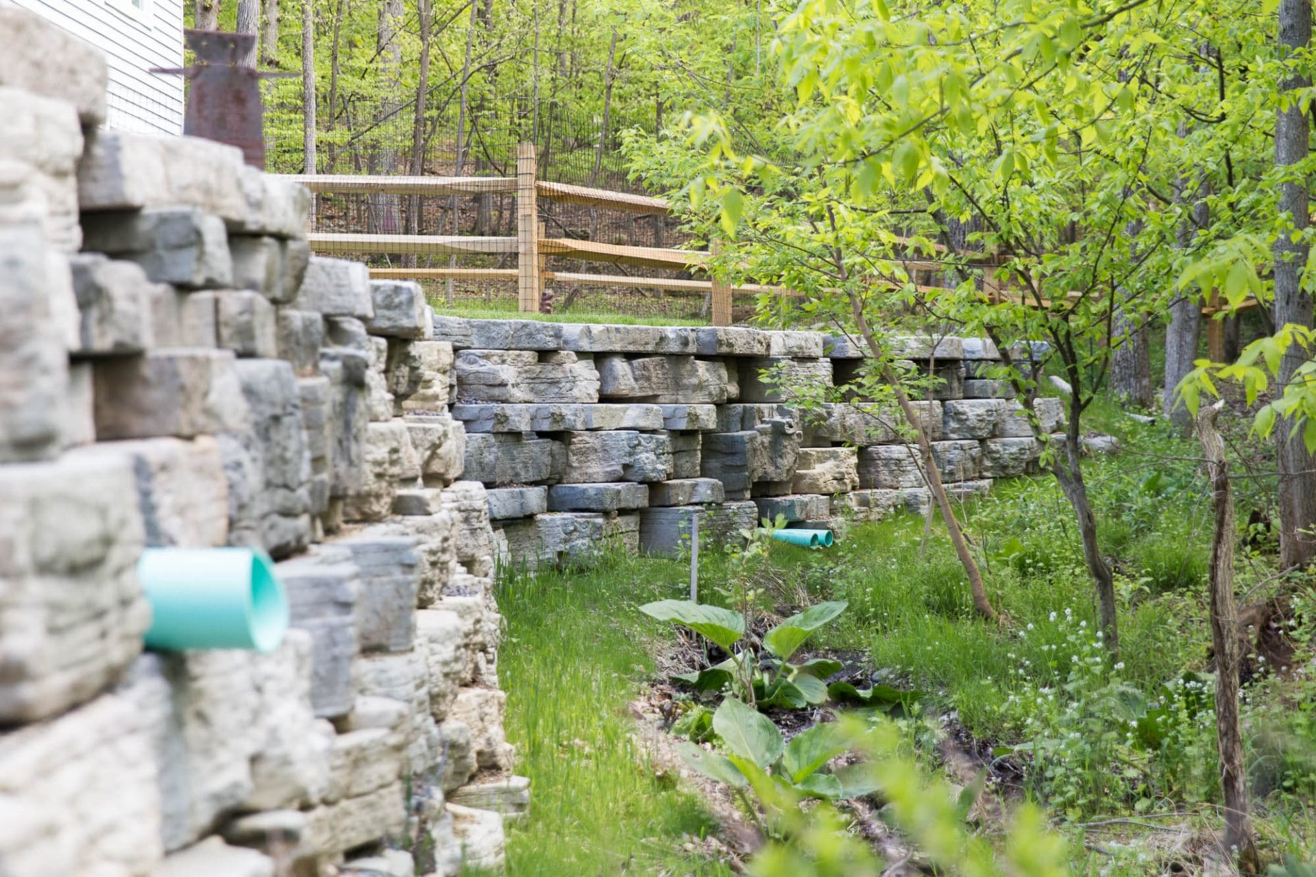 Rustic precast concrete retaining wall in New Paltz, NY installed by Masseo Landscape