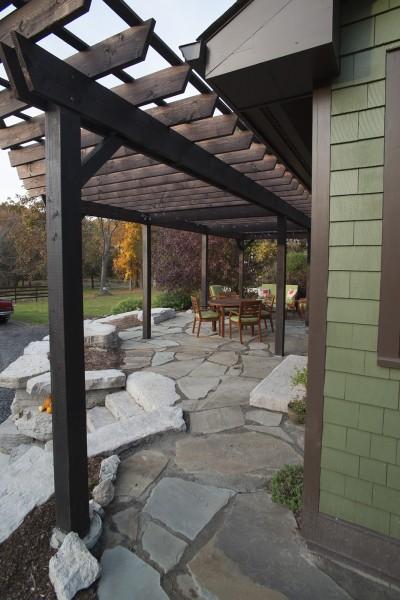 Bluestone patio and precast stone wall.
