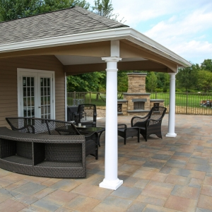 Dark patio furniture on a Belgard precast concrete stone texture patio with brown, red, and gray pavers next to a pool in New Paltz, NY.