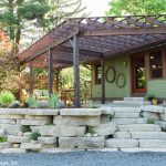 A tiered retaining wall and natural stone patio and outdoor living area, designed and installed by Masseo Landscape, Inc., Ulster County Landscapers