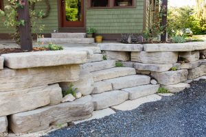 Entryway steps set into a small retaining wall planted with succulents, installed by Masseo Landscape, High Falls Landscape Designers.