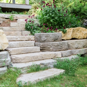 A stone-texture precast concrete entryway and steps installed by Masseo Landscape, High Falls Landscape Designers