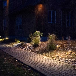 Landscaping lighting along paver pathway and in front garden beds in Ulster County, NY installed by New Paltz Landscaper Masseo Landscape, Inc.