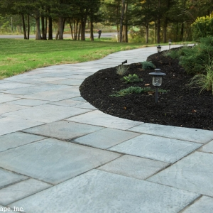 Geometric pavers cut to fit a curvilinear winding walkway layout in New Paltz, NY, designed and installed by Masseo Landscape, Inc.