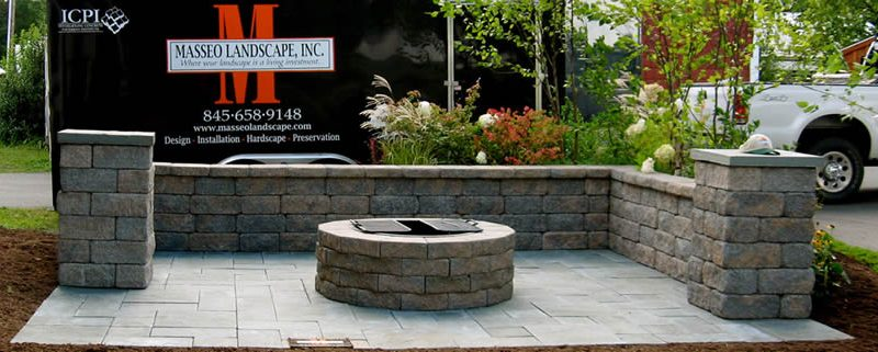 Outdoor stone fire pit install at Ulster County Fair in New Paltz, NY.