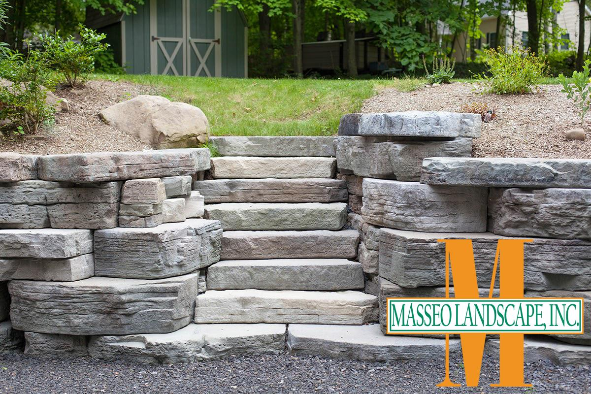 A naturalistic pre-cast step staircase in a retaining wall.