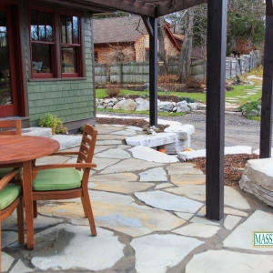 A natural bluestone patio with Rosetta Outcropping bench.
