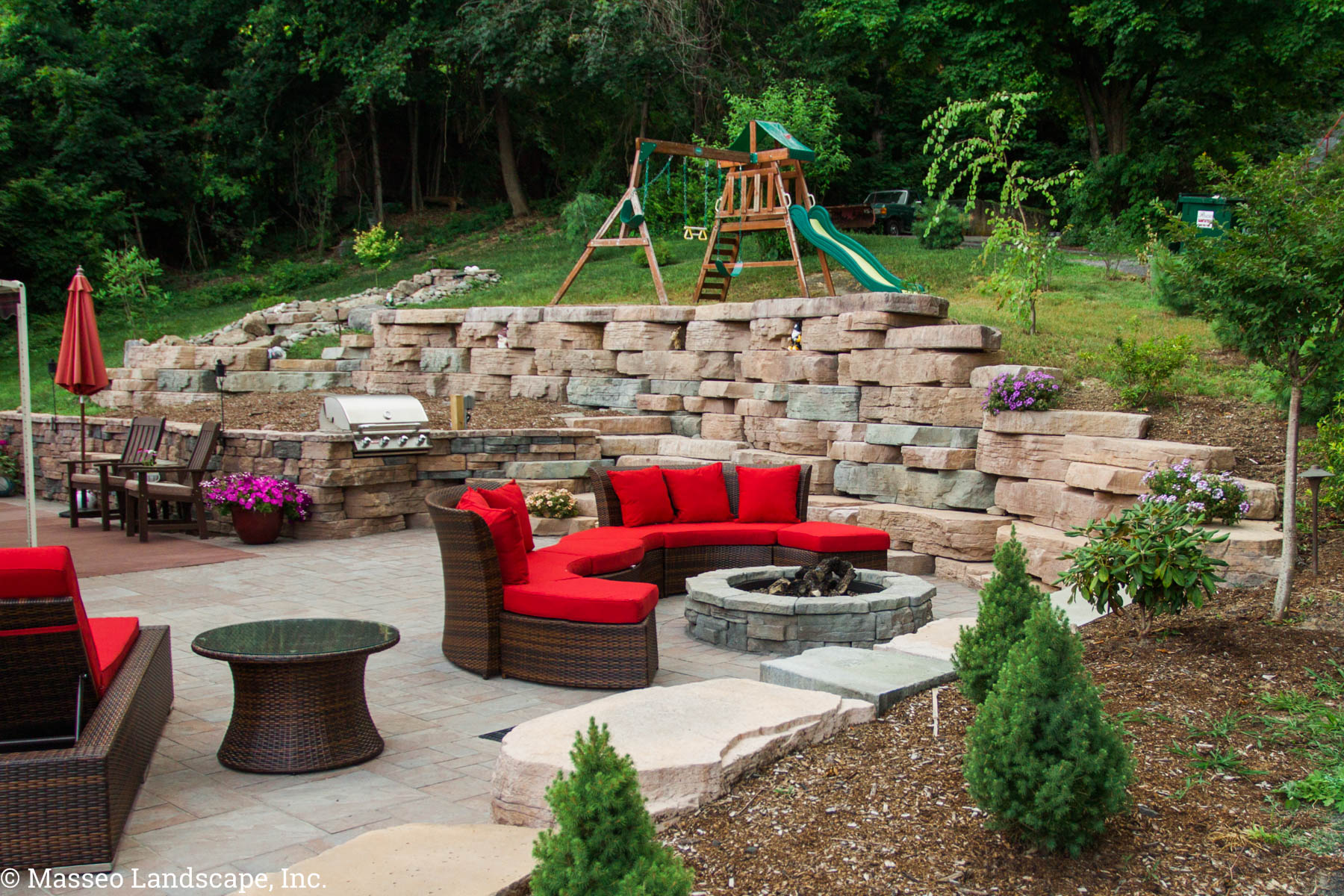 Patio and fire pit in Highland, NY, installed by Masseo Landscape, Inc. Ulster County Landscaper