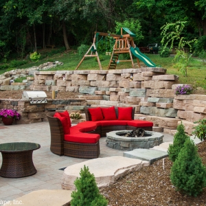 An outdoor living space with a grill, fire pit, and patio installed in Highland, NY by Masseo Landscape, Inc., best Ulster County landscape contractors.