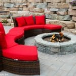 Circular fire pit, geometric patio and a Rosetta Outcropping retaining wall installed by Masseo Landscape, Inc., Highland Landscapers