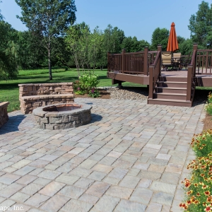 Rosetta Hardscapes patio, round fire pit, and custom-built stone benches designed and installed by New Paltz Landscapers, Masseo Landscape, Inc.