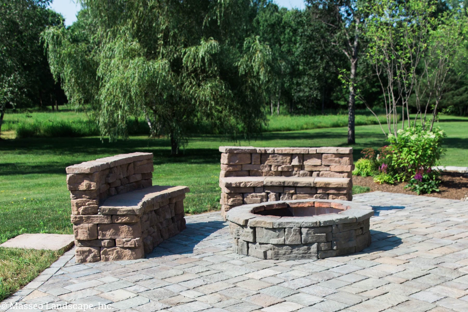 Rosetta wallstone repurposed as built-in seating around a round fire pit, designed and custom-built by Masseo Landscape, Inc.