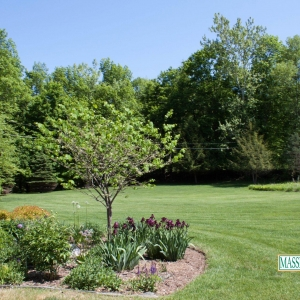 A recently mowed lawn and weeded flower bed in High Falls, NY.