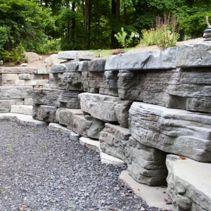 A Rosetta Outcropping wall along a driveway with a built in staircase.