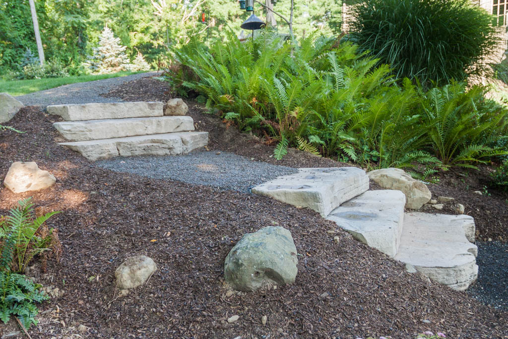 Rosetta Irregular steps and a pea gravel walkway set into a hillside with plantings in Ulster Park, NY.