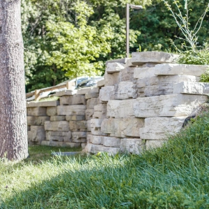 A rustic Rosetta Outcropping Retaining Wall in New Paltz, NY