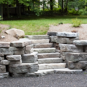 Rosetta Irregular steps set into an Outcropping retaining wall in Highland, NY