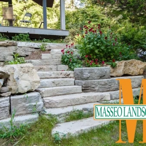 Rustic precast concrete steps with natural boulders incorporated into the design.