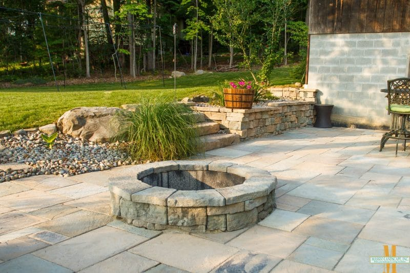 Image of outdoor fire pit on stone patio.