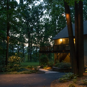 Outdoor lighting scheme around driveway with walkway, retaining walls, down lights and path lighting in New Paltz, NY.
