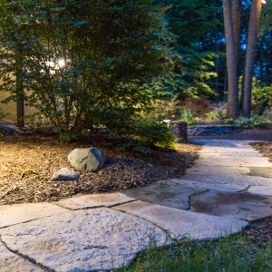 Precast concrete walkway with path lighting installed by Masseo Landscape, Inc.