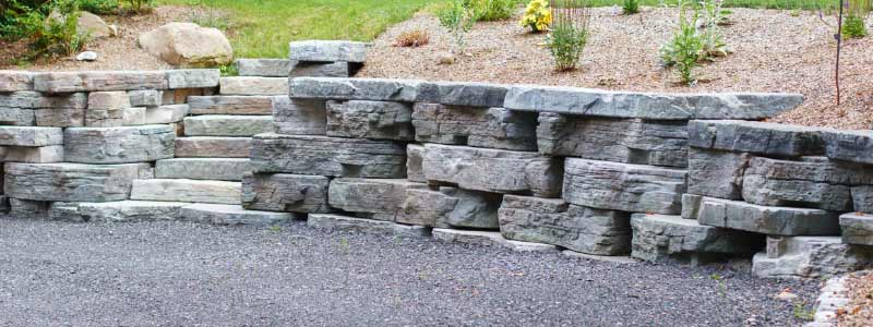 Stone textured pre-cast concrete retaining wall.