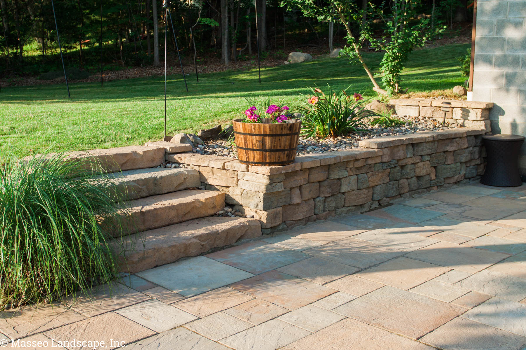 Small Rosetta retaining wall and steps to a patio in New Paltz, NY, installed by Masseo Landscape Inc, Ulster County landscapers.