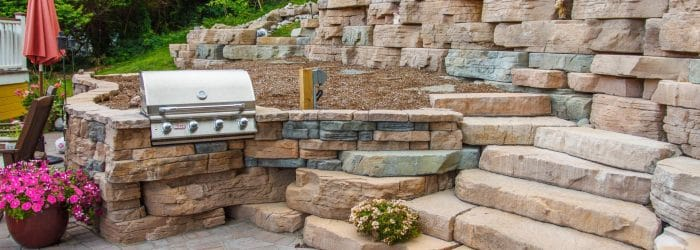 A grill station set into a Rosetta Outcropping and Belvedere Wall in Highland.