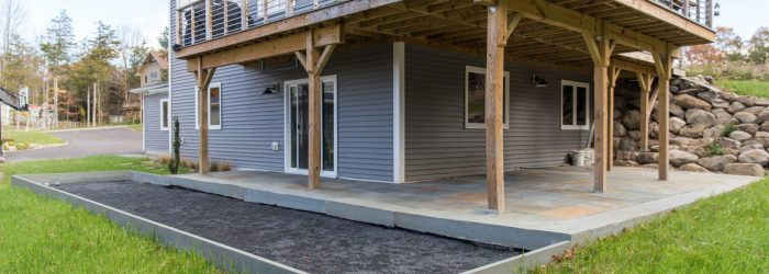 A blue stone patio with a built-in bocce ball court in New Paltz, NY