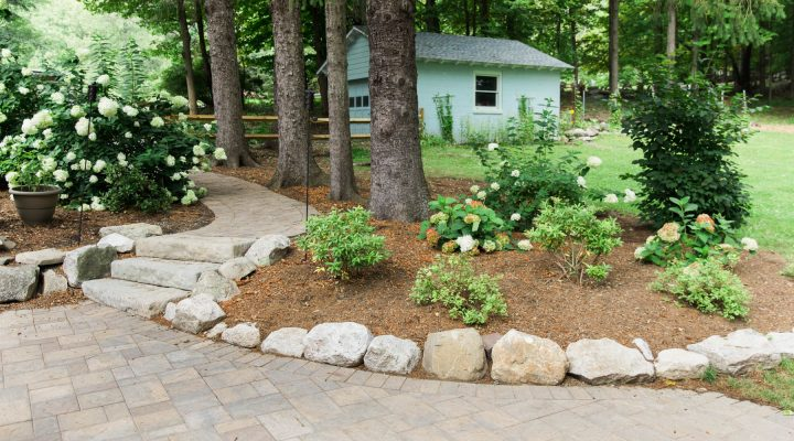 Cambridge Paver patio and walkway with natural stone border.