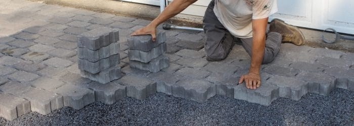Permeable driveway pavers being installed.