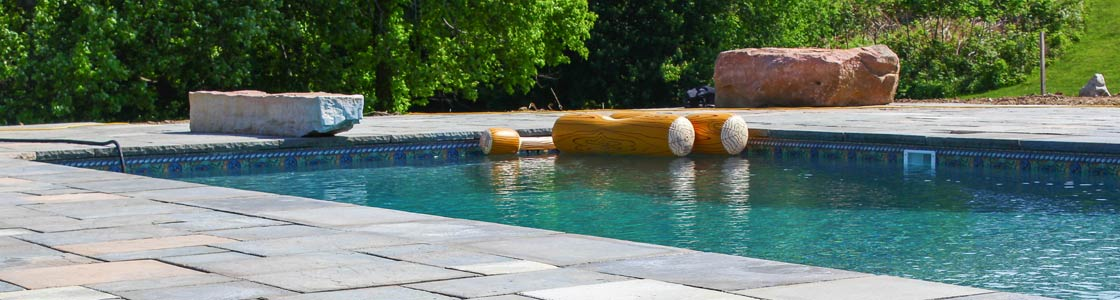 Image of stone pool patio designed and built by Masseo Landscape