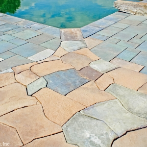A blend of two types of pavers give this pool patio and a unique texture and aesthetic.