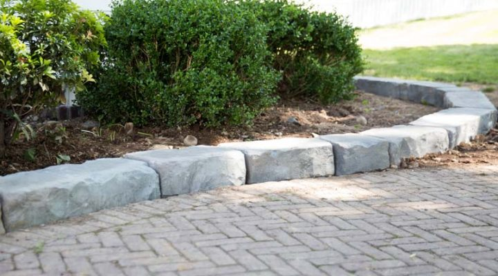 Natural stone textured curbing in a bed space, by Masseo Landscape, New Paltz Landscaping