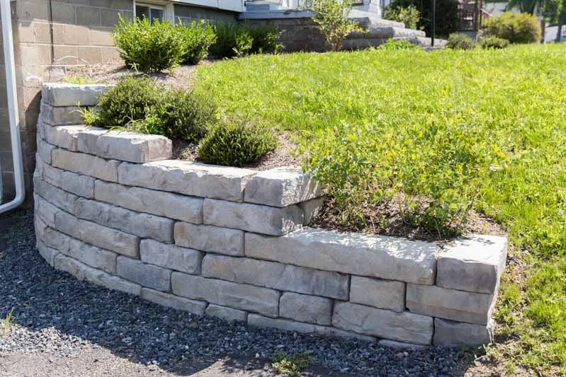 Curving retaining wall featuring Rosetta Kodah stone, by Masseo Landscape, New Paltz Landscaping