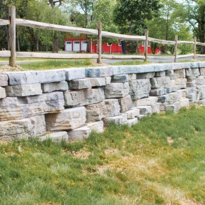 A close up detail of stone-textured precast concrete retaining wall in New Paltz, NY.