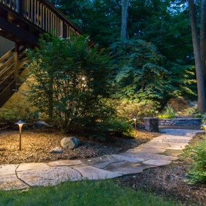 "A flagstone path with ""China Hat"" bronze path lights."