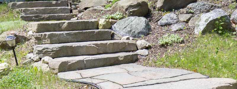 Rustic stone texture steps and a walkway.
