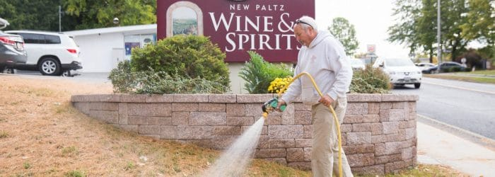 Masseo Landscape applying lawn fertilizer - Lawn care services, New Paltz Wine & Spirits