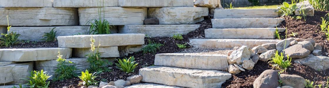 Image of stone steps with retaining wall.