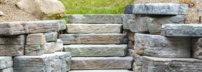 Natural looking steps built into retaining wall - Precast concrete step installation