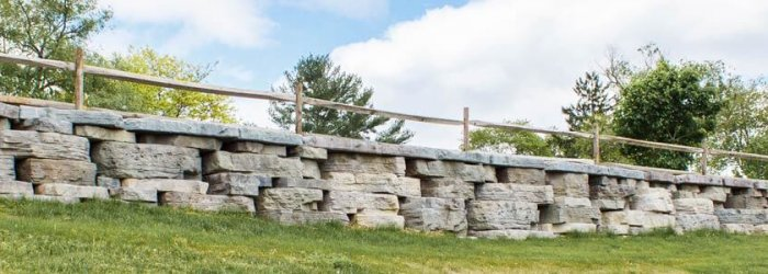 Image of long, low profile stone wall.