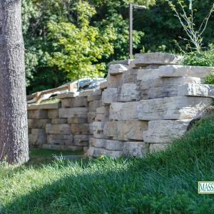 A precast concrete stone retaining wall.