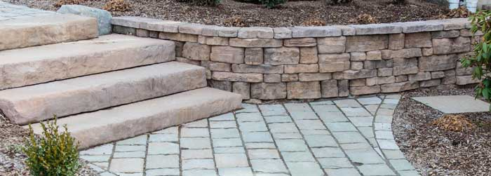 Small retaining wall with stone steps