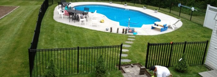 Before shot, showing pool without the new concrete patio.