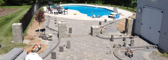 Masseo Landscape pool patio contractors building a concrete pool patio in New Paltz.
